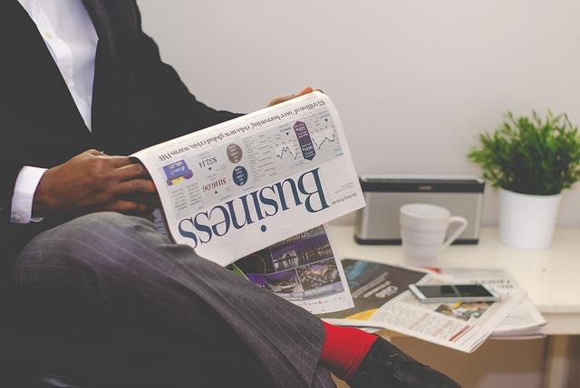 podnikatel čte noviny